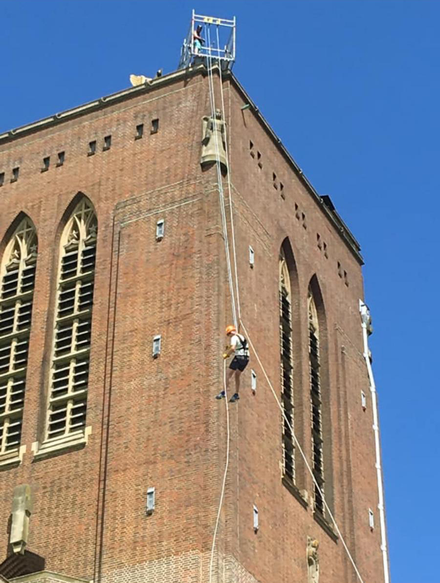 Chambers staff member abseiling down side of building
